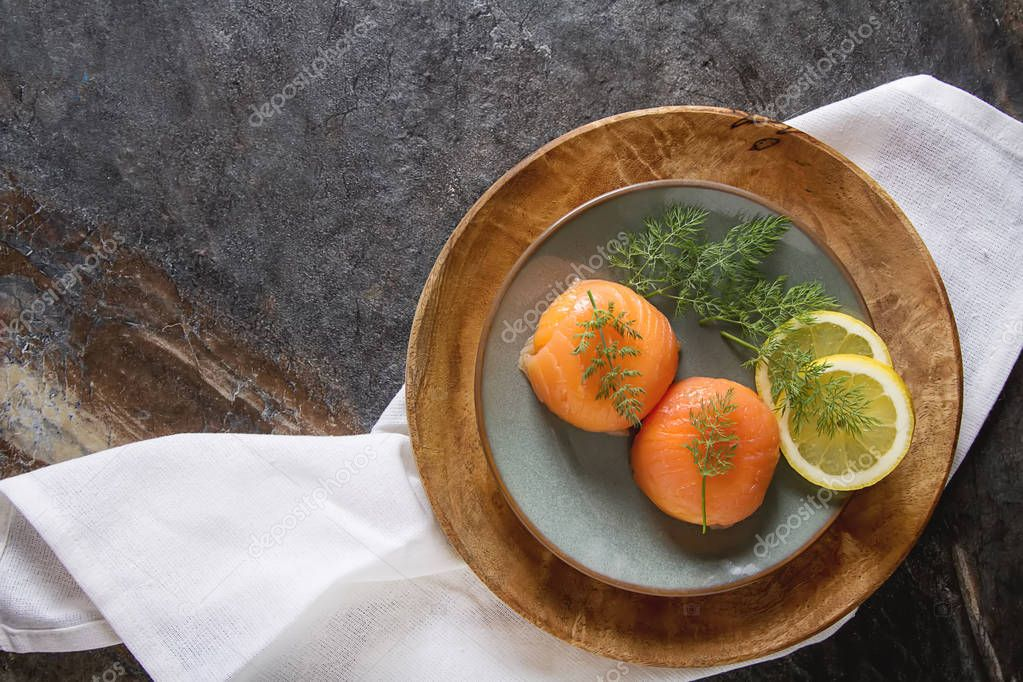 Smoked salmon, mousse, pate with dill and lemon. Dark background