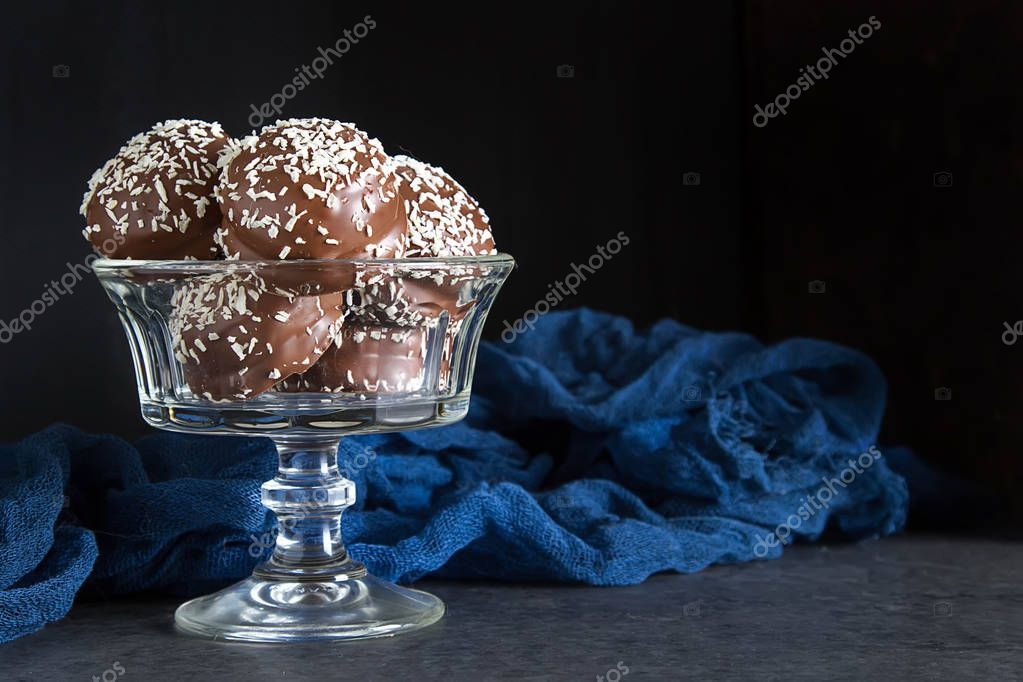 marchmallow covered with chocolate. birthday, dark background
