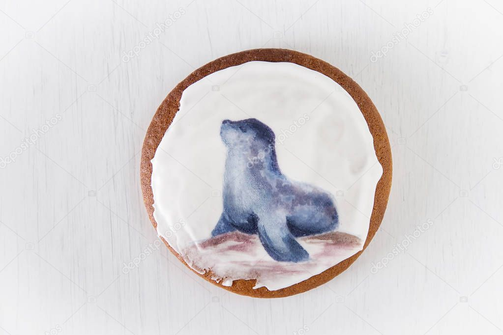 Ginger honey gingerbread cookies with a picture of sea animals. Light background