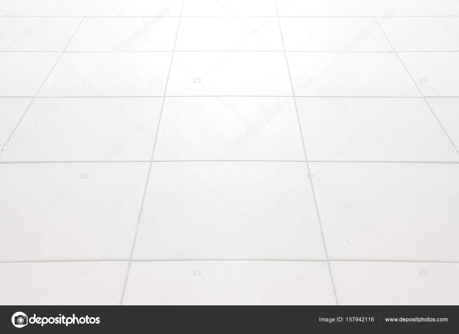 Priorità bassa del pavimento di piastrelle bianche u foto