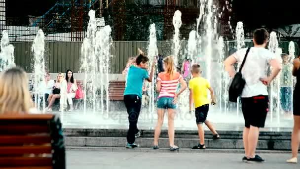 People walk near the fountains in Kiev