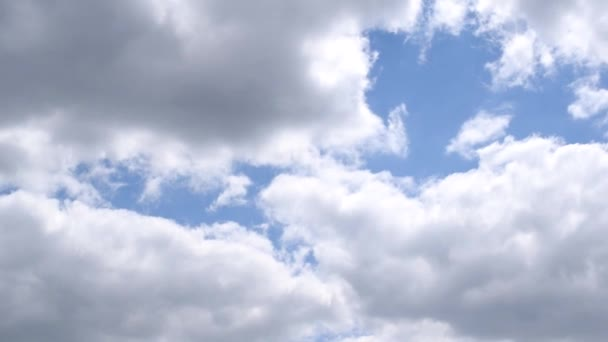 White and grey cumulus clouds on background of blue sky