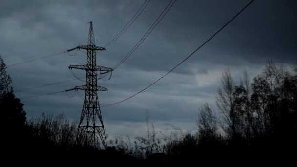 Time lapse of nightfall with clouds and transmission tower