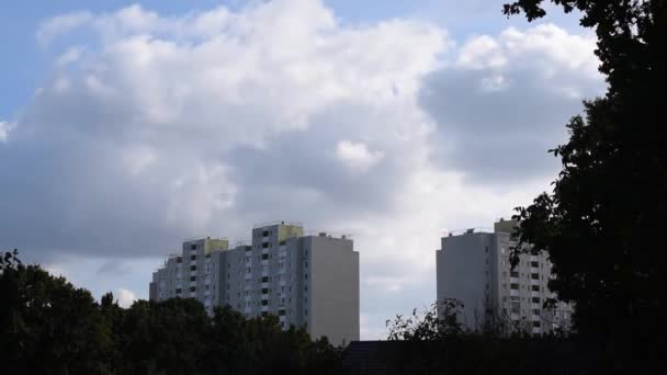 Time lapse of clouds bubbling and boiling over apartment blocks