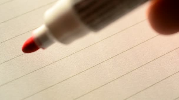 Hand writing I LOVE YOU U with red marker on lined paper