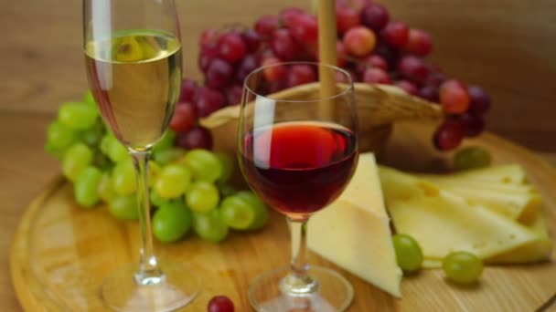Plate with Grapes, Cheese and Glasses of Wine.