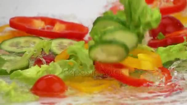 Slices of Ripe Vegetables are Falling on the Table with Water. Slow Motion.