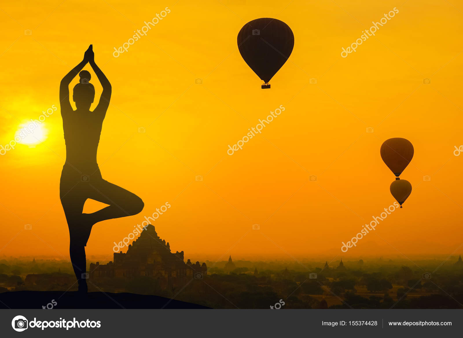 Silhouette Yoga Pose Woman Standing On The Mountain Sunset Stock Photo