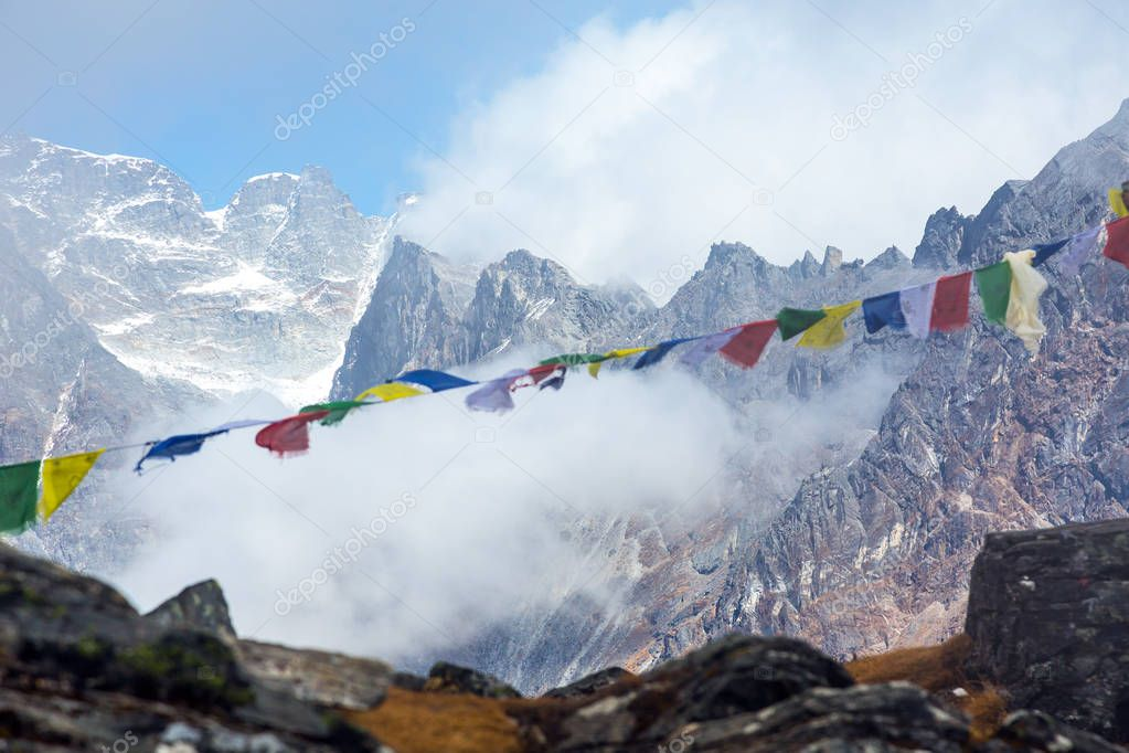 View of High Peaks Range and Prayer Flags in Nepal Himalaya