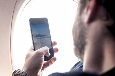 Man taking photo on telephone