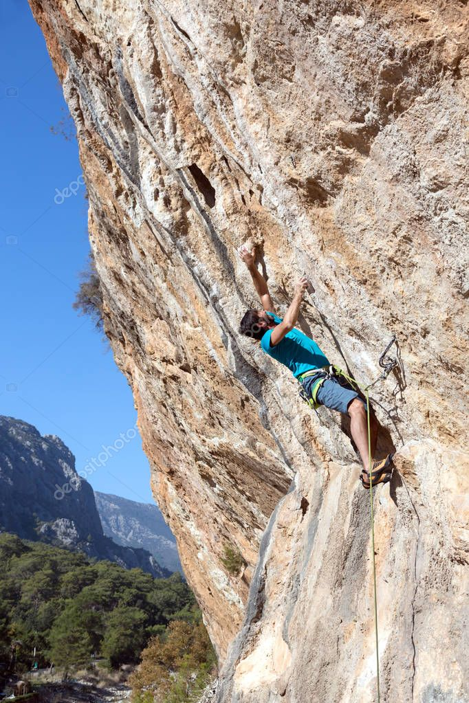 Climber hanging on rock