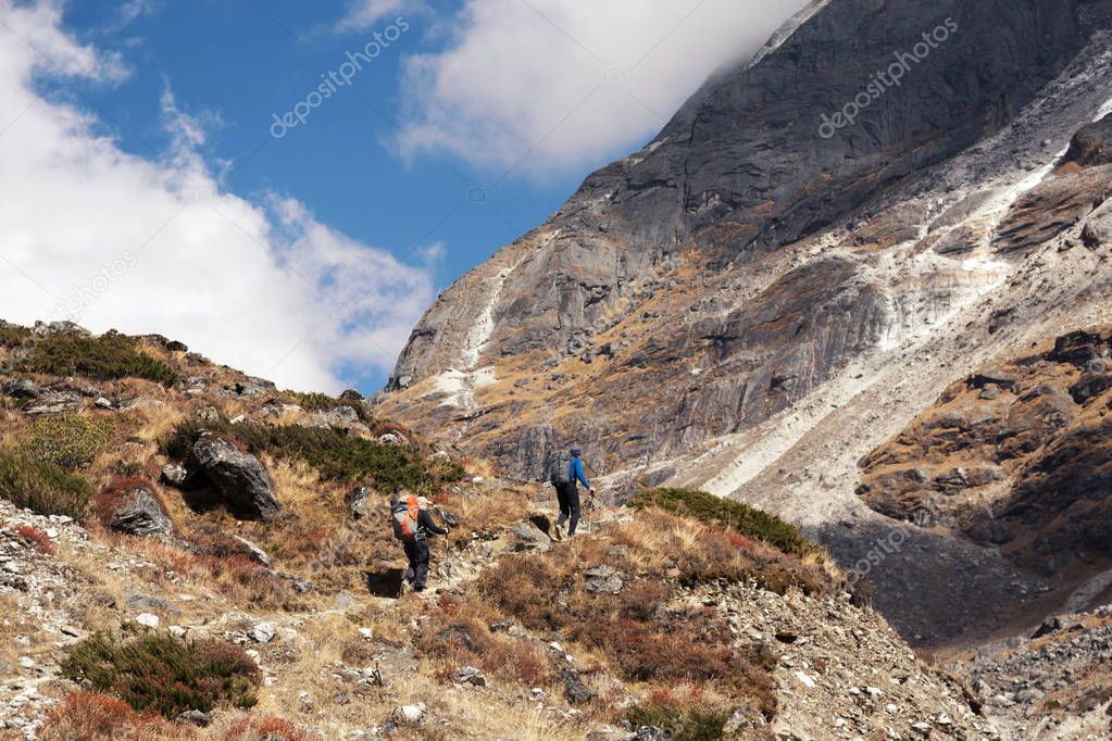 Group of Hikers walking on Mountain