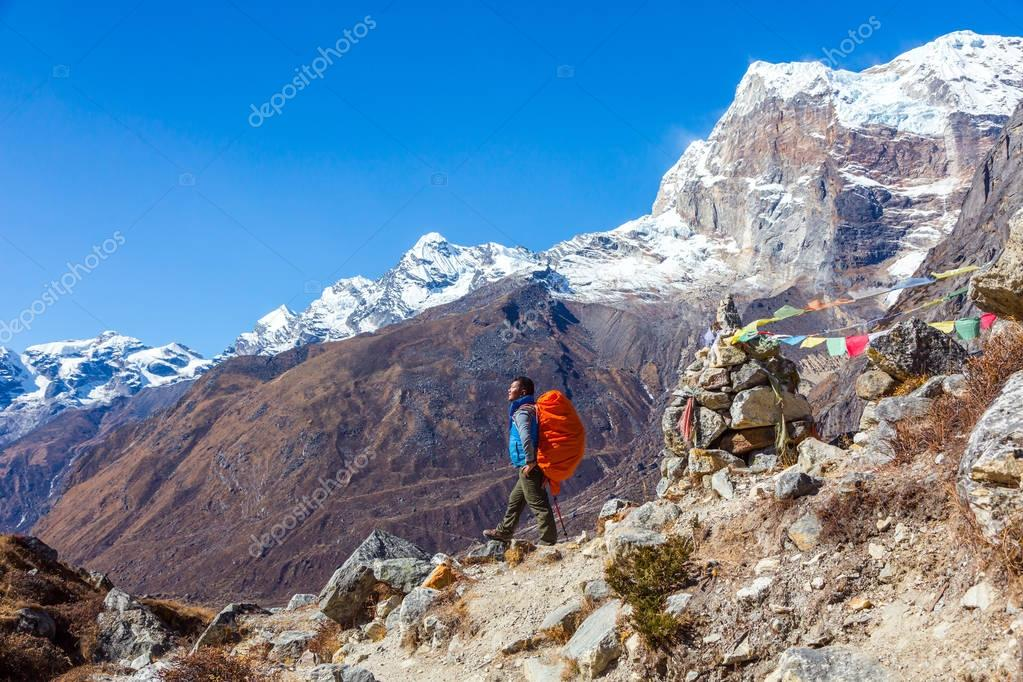 Nepalese Guide staying on Slope