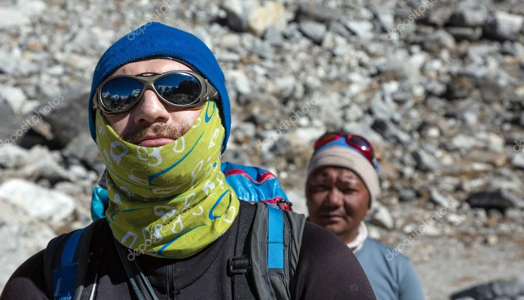 Caucasian Mountain Climber and nepalese Guide