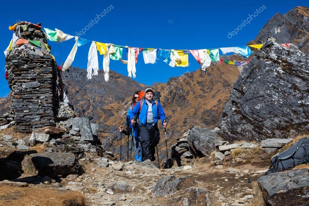 Smiling Hikers in sporty Jackets