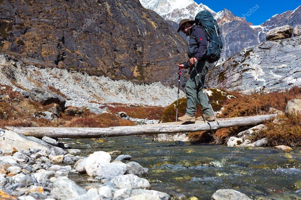 Hiker passing Mountain Creek