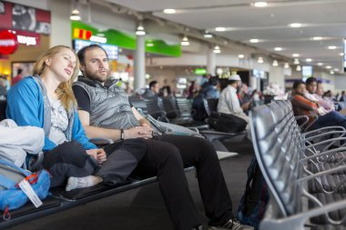 Man and woman sitting at airport