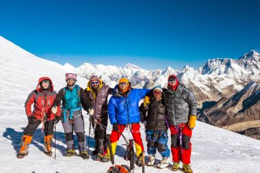 Climbers in warm high altitude jackets