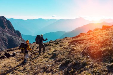 Hikers walking on grassy Trail