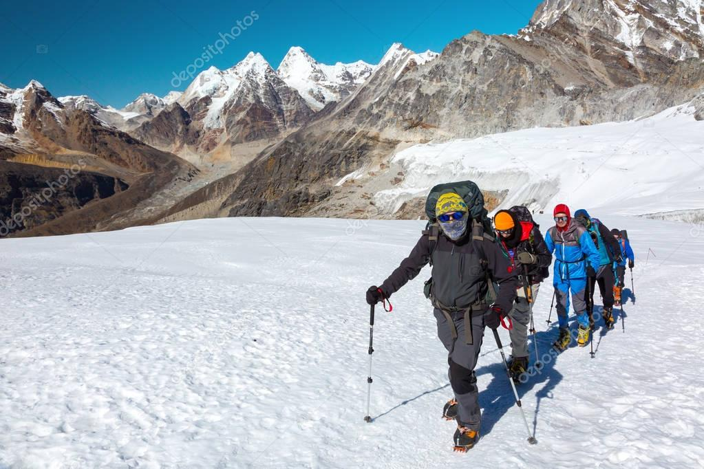 Mountain Climbers in protective Clothing