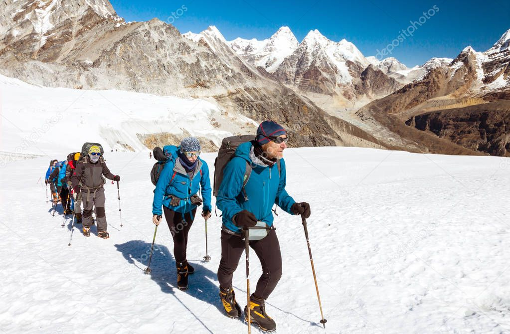 Group of Climbers walking on Glacier