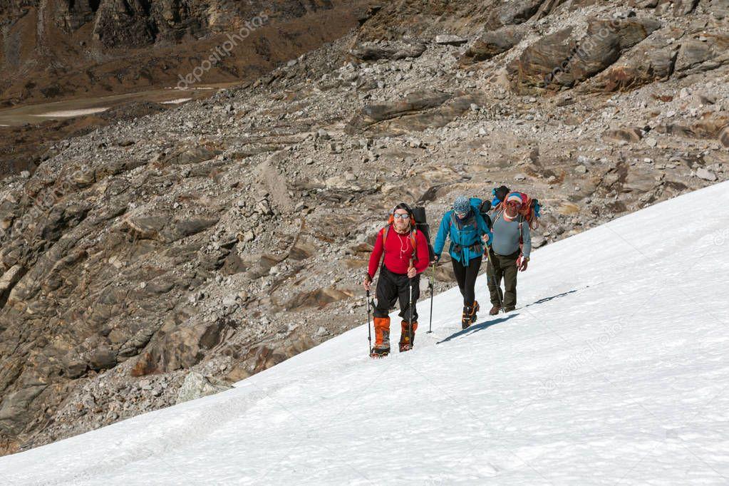 Climbers walking on Snow