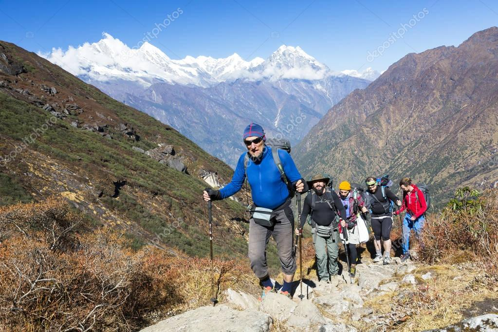Group of Climbers walking on Trail
