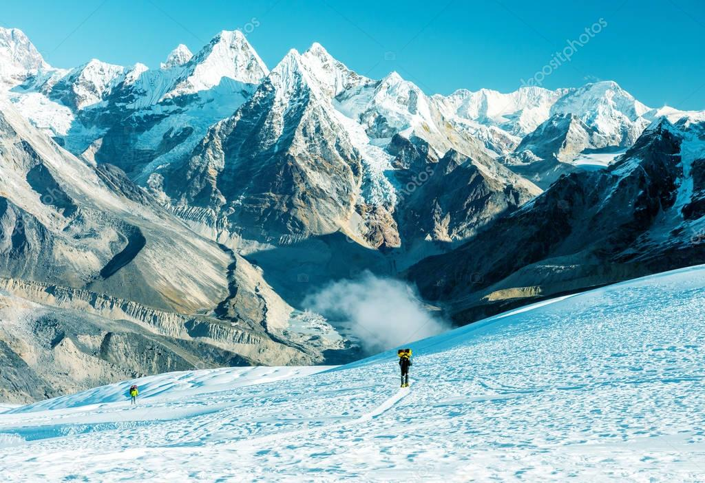 Mountain Climber carrying heavy Backpack