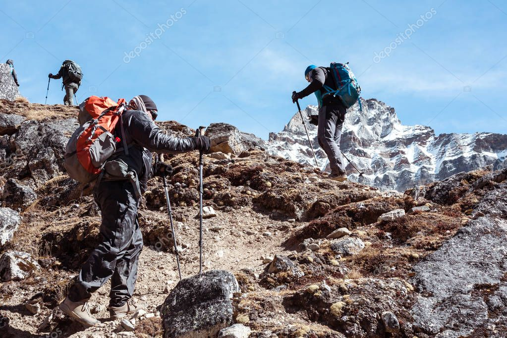 Mountain Climbers Team walking up