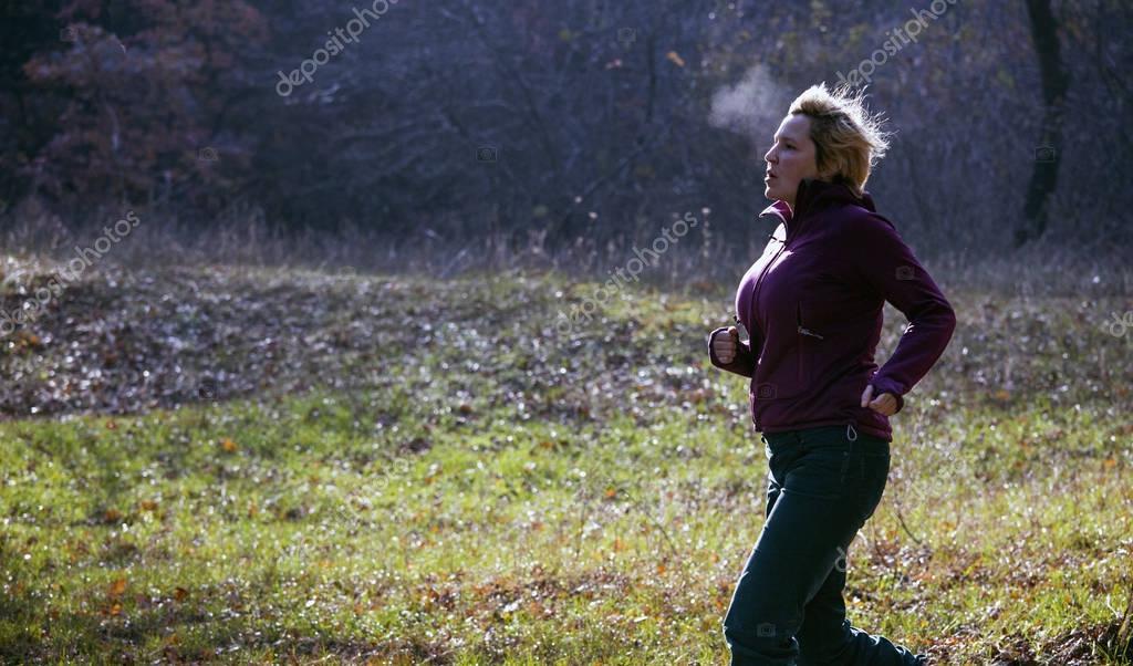 Jogger running at cold morning