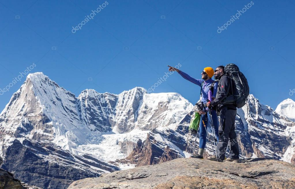 Hikers with Backpacks and climbing Gear