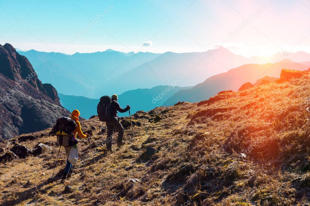 Hikers walking on grassy Trail