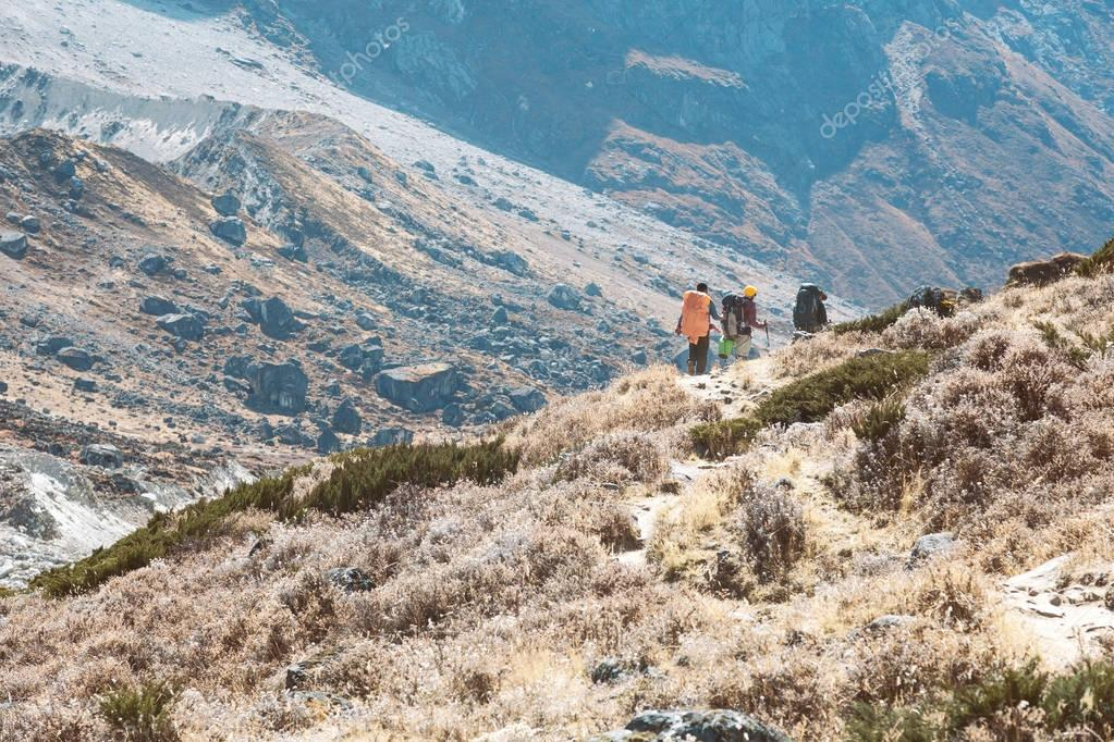 Hikers on Footpath in Mountains