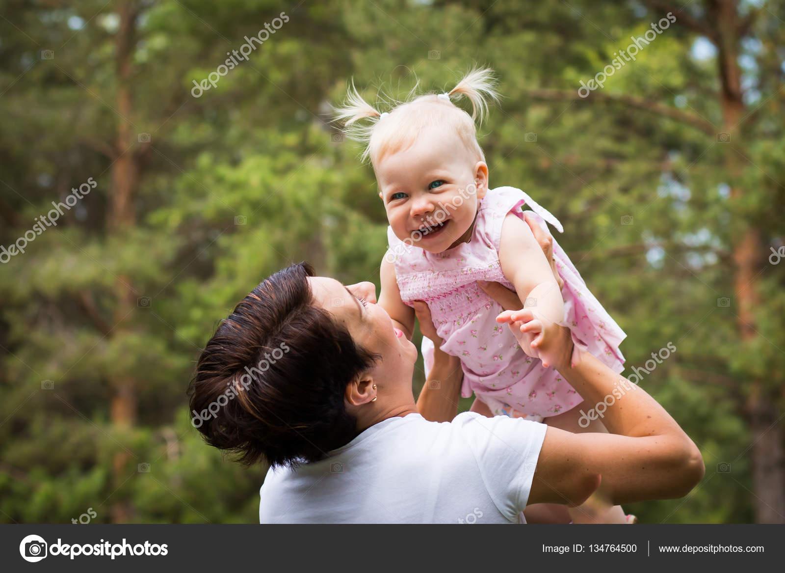 Nice cute babies Hd Wallpapers Small Cute Baby And Nice Mom Outdoors Stock Photo Depositphotos Small Cute Baby And Nice Mom Outdoors Stock Photo Keleny 134764500