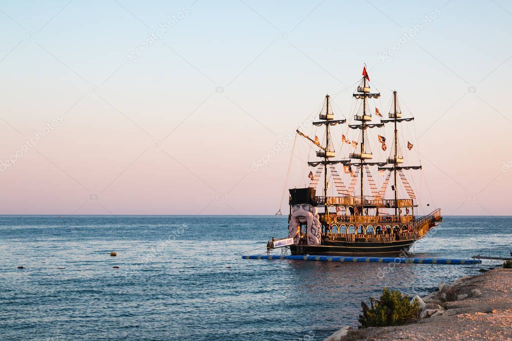 Pirate ship on the sea in a summer evening
