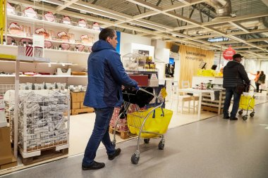 Kazan, Russia - December 22, 2019: Interior in hall of large IKEA store with a wide range of products and people in it in Russia