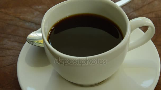 water dropping and rippled on black coffee