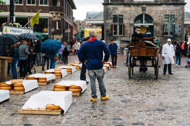 Traditional producers in Gouda Cheese Market a rainy day