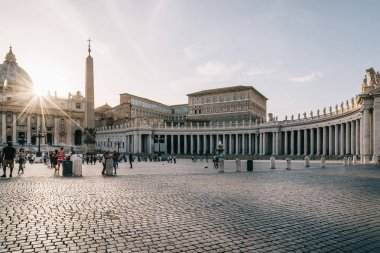 Square of St Peter at sunset with sunlight at background