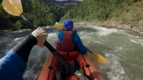 Two people on rafting on mountain river at spring time. Extreme professional water sport