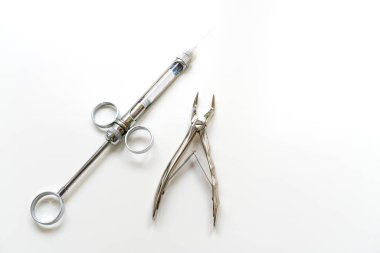 Dental instruments on a white background, syringe