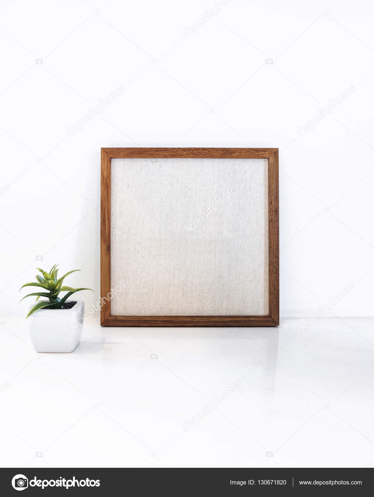 Blank Wooden frame with small Green plant succulent Hipster ...