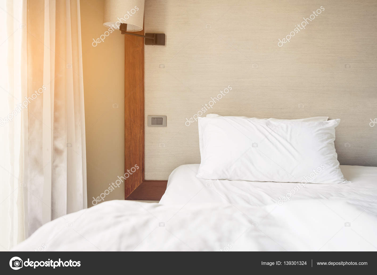 unmade bedroom with pillow bedroom interior morning light stock