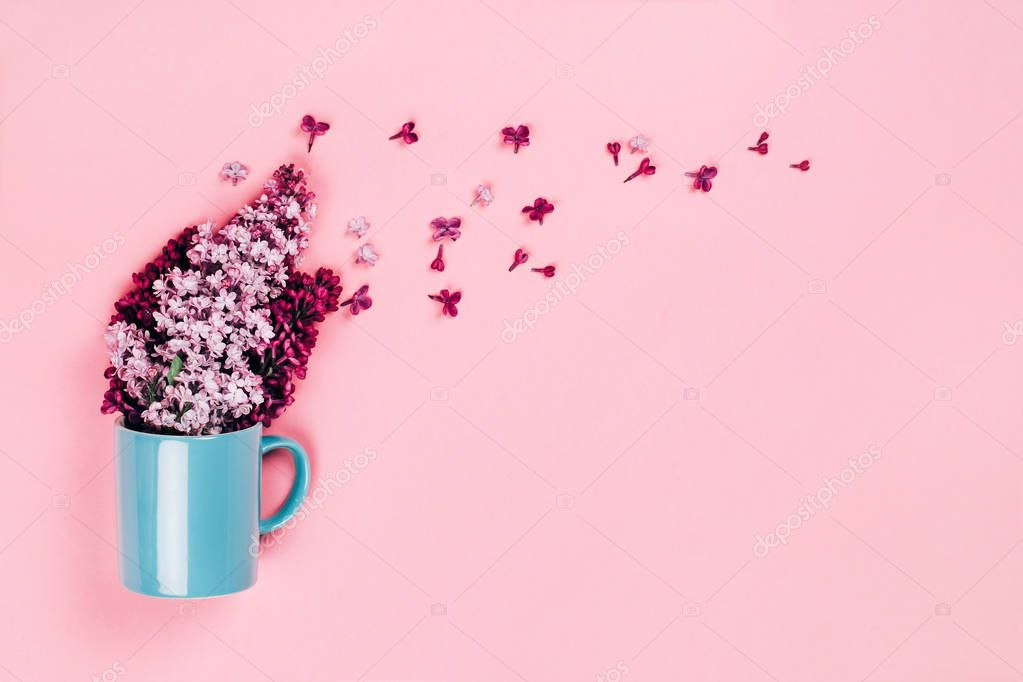 Blue cup with lilac flowers