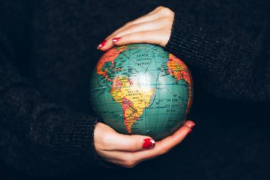 Woman's hands holding Earth.