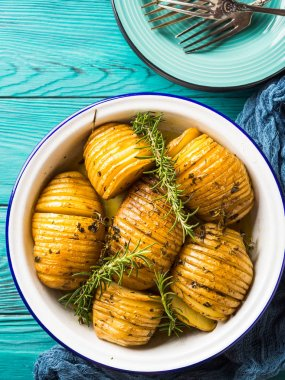 Baked potatoes cooked with herbs