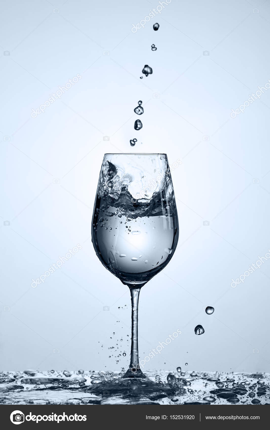 Transparent Water Pouring Into Wineglass While Standing On
