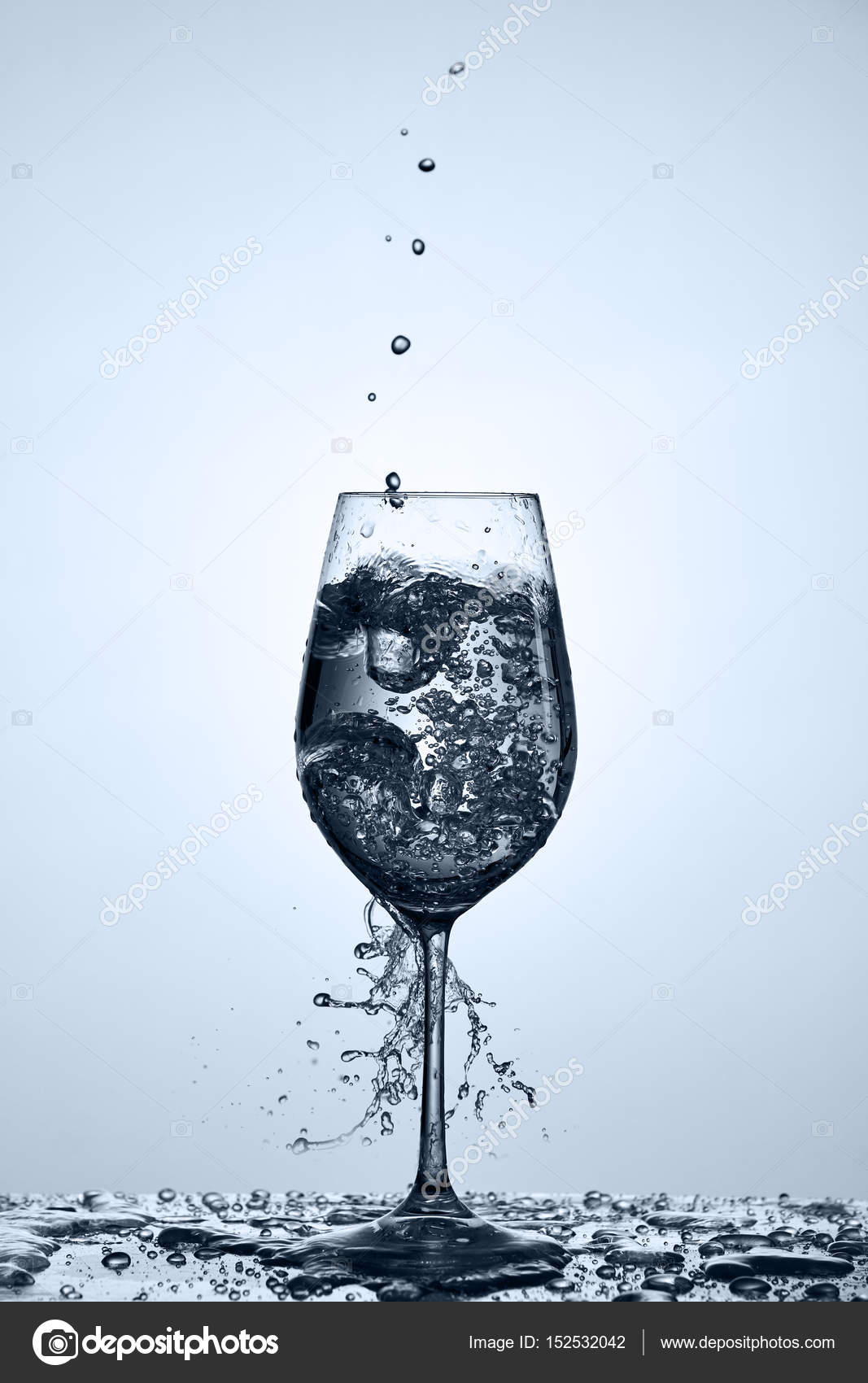 Pouring Transparent Water Into Wine Glass With Beautiful