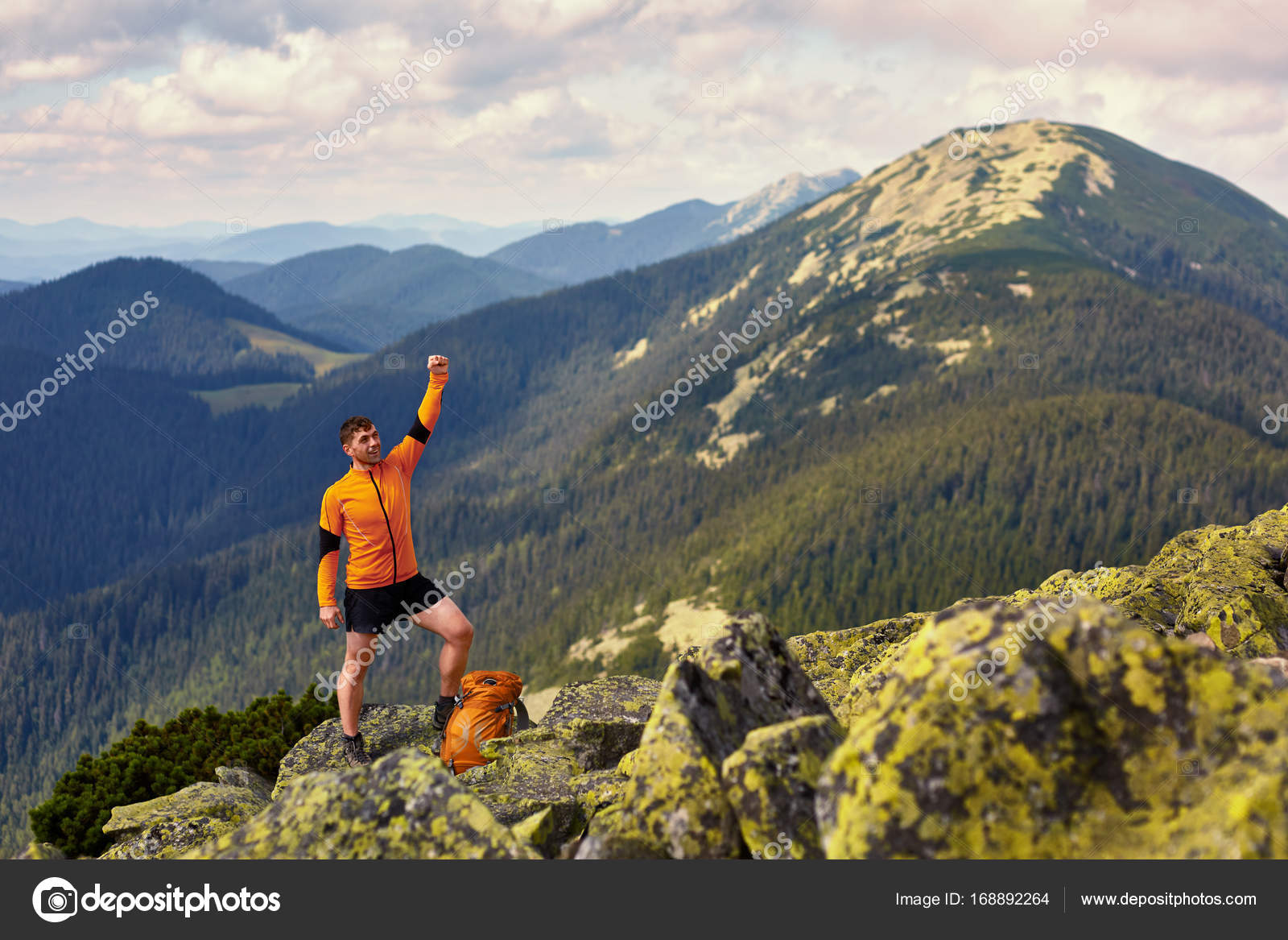 e3aeacd4853b Man traveler with backpack hiking Travel Lifestyle concept adventure active summer  vacations outdoor rocky mountains on background — Photo by aleksey rezin
