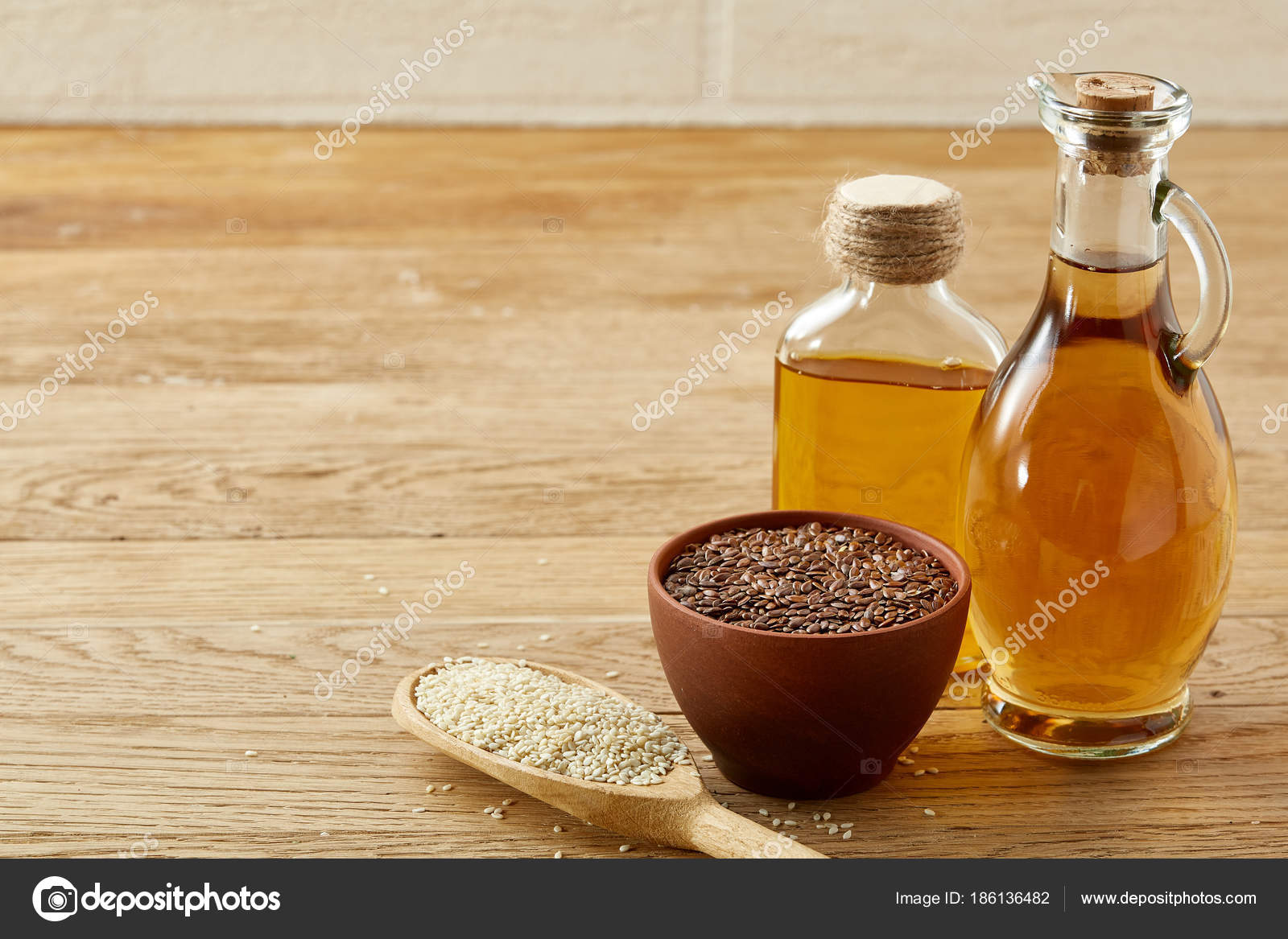 Flax Seeds In Bowl Flaxseed Oil In Glass Bottle Spoon With Rise On